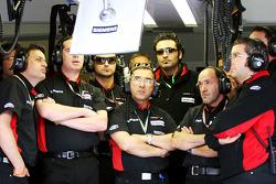 Minardi team members watch qualifying