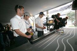 Tom Kristensen, Pierre Kaffer and Mattias Ekström play slotcars
