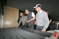 Christian Abt, Frank Stippler and Rinaldo Capello play slotcars