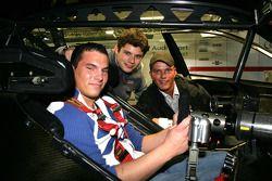 Pierre Kaffer explains his Audi A4 DTM to a fan