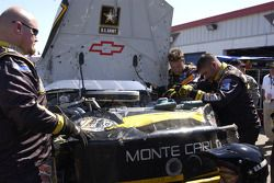 U.S. Army Chevy crew members work on the car