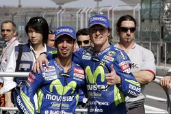 Pole winner Sete Gibernau celebrates with Marco Melandri