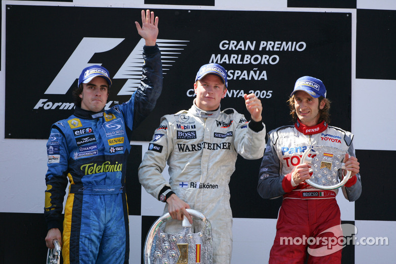 Podium : le vainqueur Kimi Raikkonen avec Fernando Alonso et Jarno Trulli