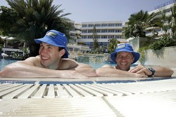 Petter Solberg and Chris Atkinson relax in the swimming pool of their hotel in Limassol