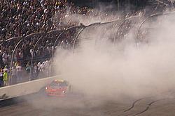 Jeff Gordon bumps the wall