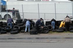 Workers repair the tire wall