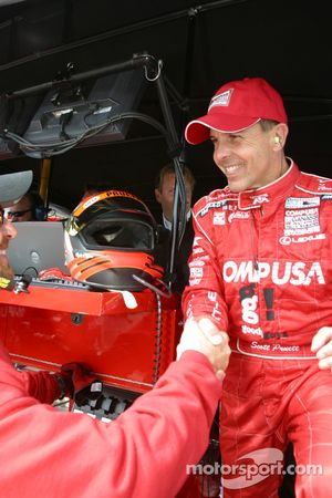 Pole winner Scott Pruett celebrates with Chip Ganassi Racing crew members