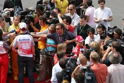 Ralf Schumacher and Michael Schumacher give interviews after the FIA press conference