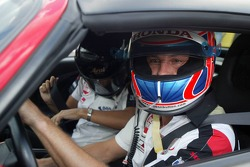 Jenson Button takes guests around the track
