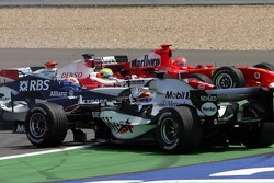 Start: Kimi Raikkonen leads the field, Mark Webber and Juan Pablo Montoya collide, Michael Schumacher and Ralf Schumacher in trouble