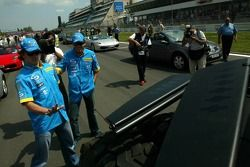 Fernando Alonso and Giancarlo Fisichella have a look at the new Batmobile