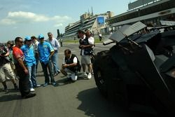 Juan Pablo Montoya, Fernando Alonso and Giancarlo Fisichella have a look at the new Batmobile