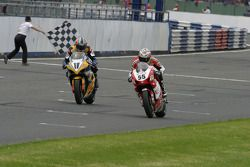 Régis Laconi takes the win ahead of Troy Corser