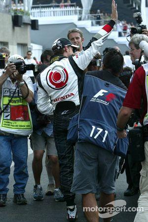 Pole winner Jenson Button celebrates