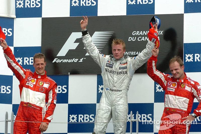 Podio: il vincitore Kimi Raikkonen con Michael Schumacher e Rubens Barrichello
