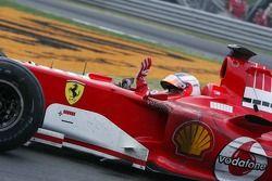 Rubens Barrichello celebrates podium finish