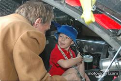 Young fan learns about Howard-Boss racecar
