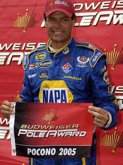 Pole winner Michael Waltrip celebrates