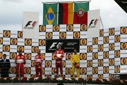 Podio: ganador de la carrera Michael Schumacher, segundo lugar Rubens Barrichello y tercer lugar Tiago Monteiro