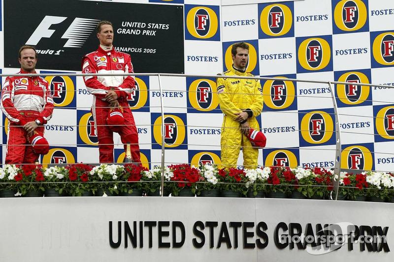 Podium: race winner Michael Schumacher with Rubens Barrichello and Tiago Monteiro