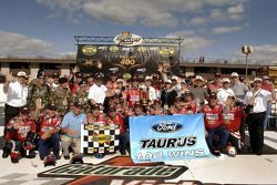 Victory lane: race winner Greg Biffle celebrates 100th NASCAR Nextel Cup victory for the Ford Taurus