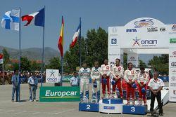Podio: Sébastien Loeb y Daniel Elena con Toni Gardemeister y Jakke Honkanen, y Carlos Sainz y Marc M