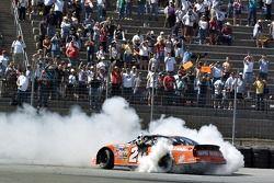 Race winner Tony Stewart celebrates with a burnout