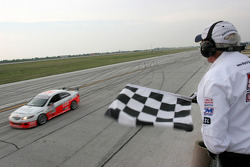Pierre Kleinubing takes the checkered flag