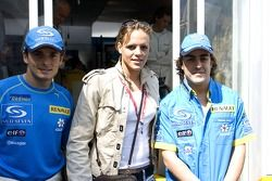 Giancarlo Fisichella and Fernando Alonso with French swimmer Laure Manaudou