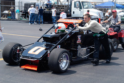 Nick Lundgreen pushes his car