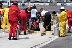 The session came to an early end when safety crews cleaned up Jay Drake's fuel leak