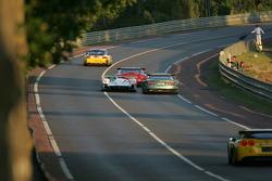 #2 Champion Racing Audi R8: Frank Biela, Allan McNish, Emanuele Pirro passes #59 Aston Martin Racing Aston Martin DBR9: David Brabham, Stephane Sarrazin, Darren Turner