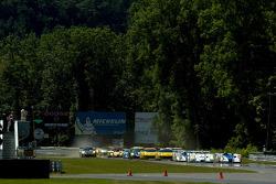 Start: #1 Champion Racing Audi R8: JJ Lehto, Marco Werner, #16 Dyson Racing Team Inc Lola EX257 AER: James Weaver, Butch Leitzinger battle for the lead
