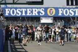Journalist Bob McKenzie runs naked around Silverstone after a promise made if McLaren wins a race in 2004