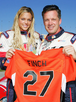 Jennie Finch of the Chicago Bandits softball team with Wally Dallenbach after taking a trip around the track