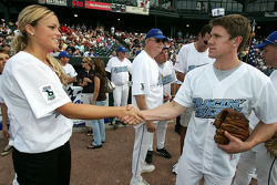 Jennie Finch of the Chicago Bandits softball team shakes hands with NASCAR driver Carl Edwards before the Racin' the Bases Celebrity Softball game benefitting the Victory Junction Gang Camp