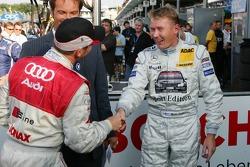 Pole winner Tom Kristensen celebrates with Mika Hakkinen