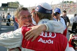 Pole winner Tom Kristensen celebrates with Mattias Ekström