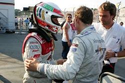 Pole winner Tom Kristensen celebrates with Jamie Green