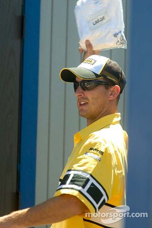 Colin Edwards of Yamaha Gauloises Team throws T-Shirts to the crowd in the MotoGP paddock