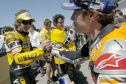 Race winner Nicky Hayden congratulated by Valentino Rossi