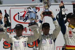 GT2 podium: class winnners Timo Bernhard and Romain Dumas, with Michael Petersen, Patrick Long and Jorg Bergmeister, and Wolf Henzler and Mike Rockenfeller