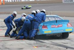A.J. Fike's crew try to lift the car for the jack man