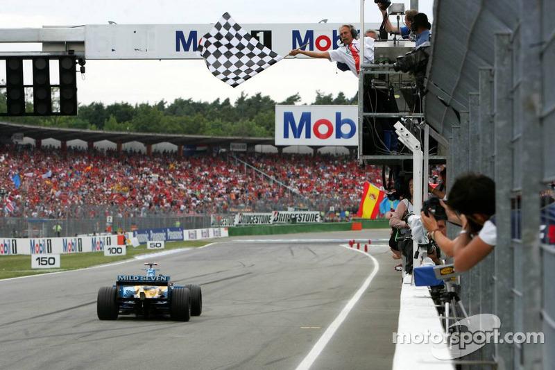 Fernando Alonso takes checkered flag