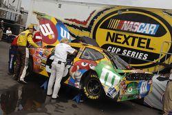 Elliott Sadler inspects his wrecked car