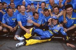 Race winner Fernando Alonso celebrates with Renault F1 team members