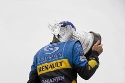 Podium: race winner Fernando Alonso celebrates