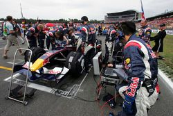 Red Bull Racing crew members on the starting grid