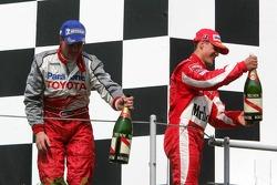 Podium: champagne for Ralf Schumacher and Michael Schumacher