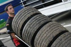 Minardi team member at work after the race